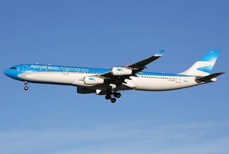 argentinian flag: Madrid, Spain - March 5, 2015: An Aerolineas Argentinas Airbus A340 with the registration LV-CSX landing at Madrid Airport (MAD). Aerolineas Argentinas is the Argentinian flag carrier airline with its headquarters in Buenos Aires.