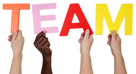 multi ethnic group: Multi ethnic group of people holding the word Team isolated Stock Photo
