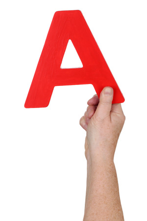 alphabet letter a: Hand holding letter A from alphabet isolated on a white background