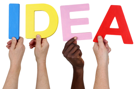 multi ethnic group: Multi ethnic group of people holding the word idea isolated Stock Photo