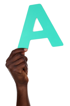Hand holding letter A from alphabet isolated on a white background photo