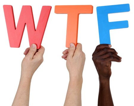 wtf: Multi ethnic group of people holding the word WTF isolated Stock Photo