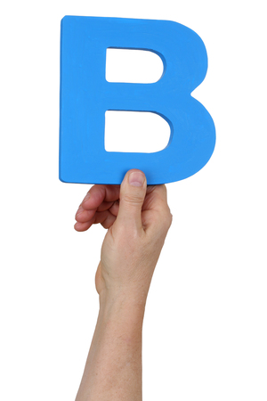 letter b: Hand holding letter B from alphabet isolated on a white background