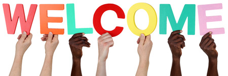 refugees: Multi ethnic group of people holding the word welcome isolated Stock Photo