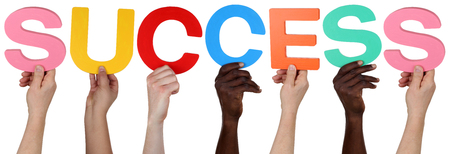 multi racial group: Multi ethnic group of people holding the word success isolated
