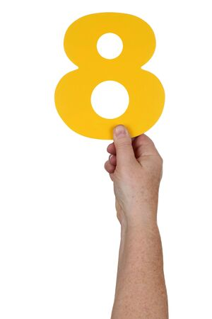 number 8: Hand holding number 8 isolated on a white background