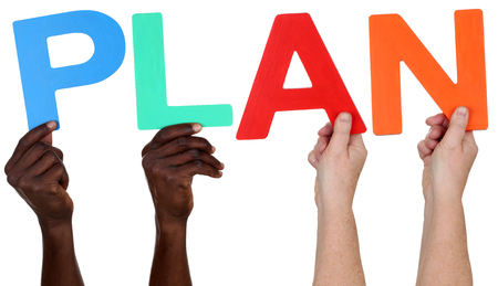 multi ethnic group: Multi ethnic group of people holding the word plan isolated