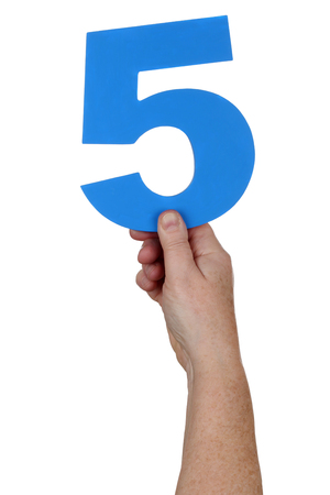 number 5: Hand holding number 5 isolated on a white background