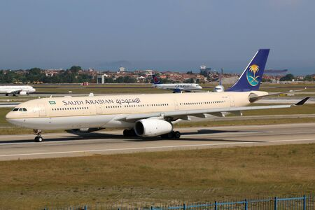 ist: Istanbul, Turkey - May 28, 2014: A Saudi Arabian Airlines Airbus A330-300 with the registration HZ-AQF takes off from Istanbul Ataturk International Airport (IST) in Turkey. Saudi Arabian Airlines is the international airline of Saudi Arabia. Editorial