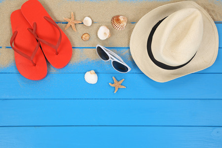 flip flops on the beach: Beach scene in summer on vacation with shells, hat, copyspace Stock Photo