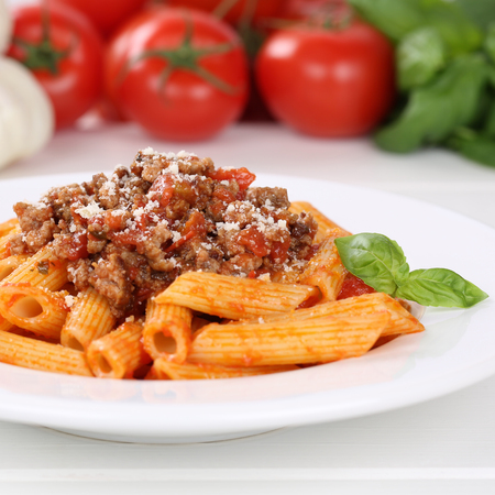 Italian cuisine Penne Rigate Bolognese sauce noodles pasta meal on a plate