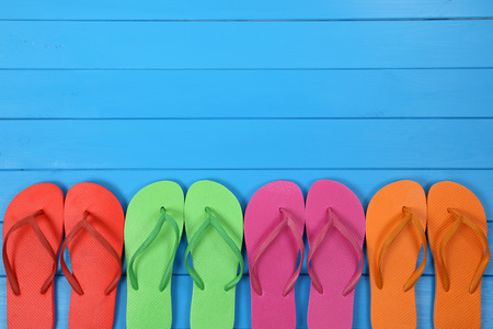 flip flops on the beach: Flip Flops sandals in summer on vacation, holidays with copyspace Stock Photo