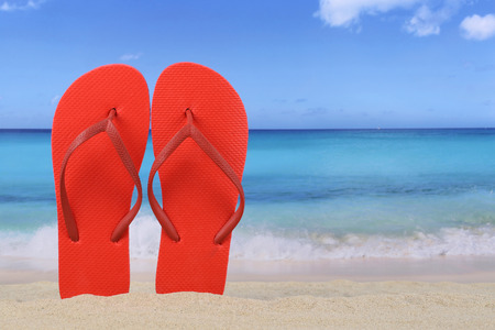 copyspace: Flip Flops sandals in summer on beach and vacation with sand and copyspace