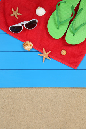 beach holiday: Beach scene in summer on vacation, holiday with sand, sunglasses and towel