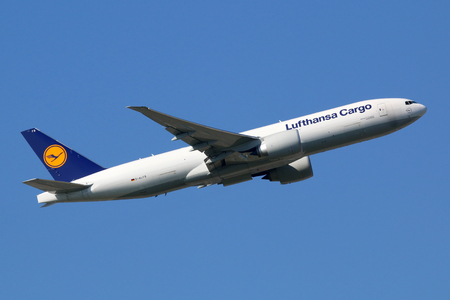 freighter: Frankfurt, Germany - September 17, 2014: A Lufthansa Cargo Boeing 777-F freighter taking off from Frankfurt International Airport (FRA). Lufthansa Cargo is a German cargo airline with its headquarters at Frankfurt airport. Editorial