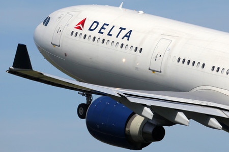 Amsterdam, Netherlands - April 21, 2015: A Delta Air Lines Airbus A330-300 with the registration N808NW takes off from Amsterdam Airport (AMS) in the Netherlands. Delta is one out of the three major American legacy carriers with its headquarters in Atlant Editorial