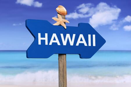 direction sign: Hawaii with beach and sea in summer on vacation Stock Photo