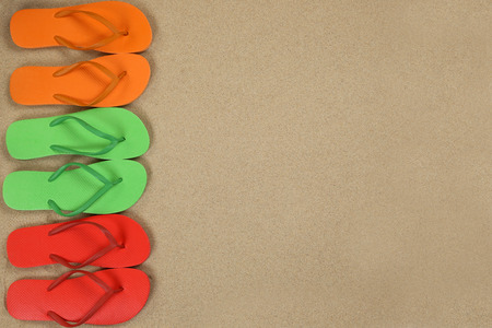 flip flops: Flip Flops sandals on the beach in sand summer holiday with copyspace