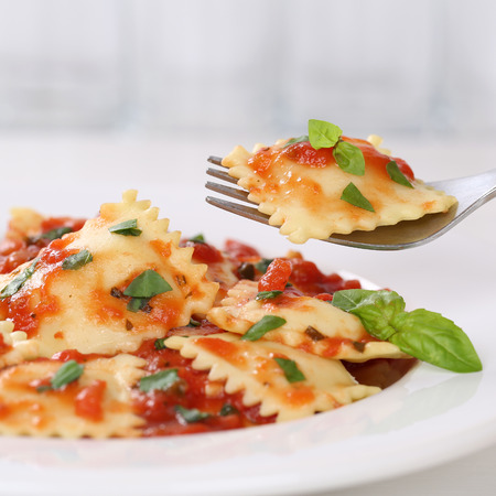 Italian cuisine eating Ravioli with tomato sauce meal with basil on a plate