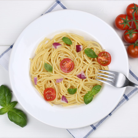 Italian Cuisine Spaghetti With Basil And Tomatoes Noodles Pasta Meal From Above On A Plate Photo