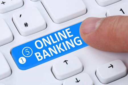 online banking: Internet online banking financial transaction push button paying on computer Stock Photo
