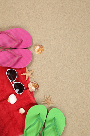 flip flops on the beach: Beach scene in summer on vacation, holiday with sunglasses, towel and copyspace