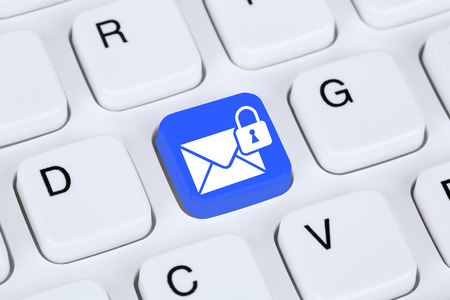 security icon: Sending encrypted E-Mail protection secure mail via internet on computer keyboard with letter symbol