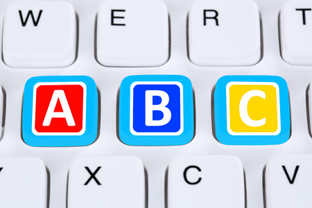 computer lessons: Back to school learning ABC for student on computer internet private lessons Stock Photo
