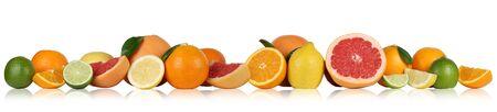 naranjas: Frutas naranjas limón pomelo en una fila Foto de archivo
