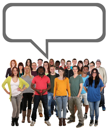 Happy multi ethnic group of smiling young people talking with speech bubble and copyspace Stock Photo
