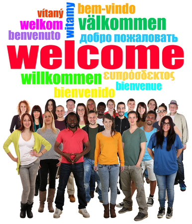 Multi ethnic group of smiling young people saying welcome in different languages in tag cloud