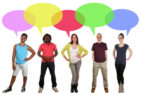 multi racial group: Smiling multicultural multi ethnic group of young people talking with speech bubble and copyspace Stock Photo