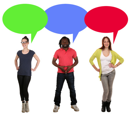speech bubble: Smiling multicultural multi ethnic young people talking with speech bubble and copyspace Stock Photo