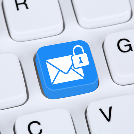encrypted: Computer concept sending encrypted E-Mail protection secure mail via internet on computer keyboard with letter symbol Stock Photo