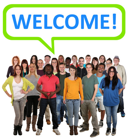 multi ethnic: Large multi ethnic group of smiling young people with word welcome