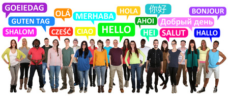 Multi ethnic group of smiling young people saying hello in different languages Stock Photo