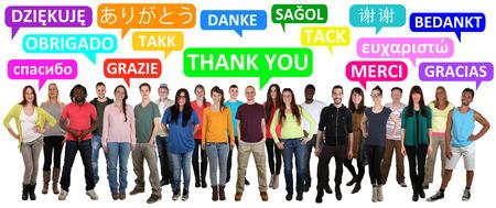 Multi-etnische groep van lachende jongeren zeggen dank u in verschillende talen Stockfoto