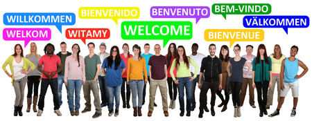 multi ethnic: Multi ethnic group of smiling young people saying welcome in different languages