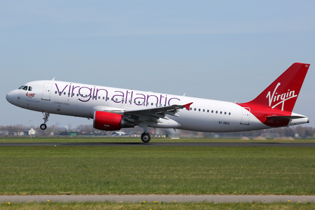 bases: Amsterdam, Netherlands - April 21, 2015: A Virgin Atlantic Airbus A320 with the registration EI-DEO taking off from Amsterdam Airport (AMS). Virgin Atlantic is a British airline with bases at London Heathrow and Gatwick airport. Editorial