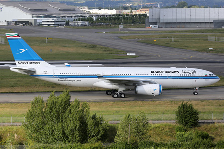 airways: Toulouse, France - May 26, 2015: A Kuwait Airways Airbus A330-200 taxis at Toulouse Airport (TLS) in France. Kuwait Airways is the state-owned national airline of Kuwait with 23 aircraft in operation.