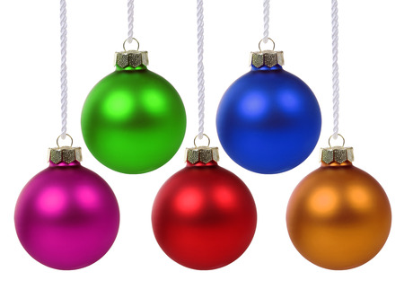 hanging on: Colorful Christmas balls hanging isolated on a white background