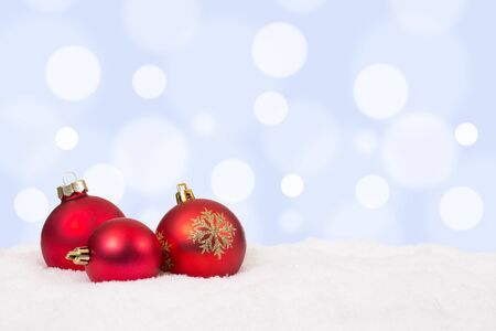 copyspace: Red Christmas balls background decoration with snow and copyspace