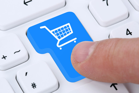 shop online: Online shopping buying order internet shop concept with shopping cart Stock Photo