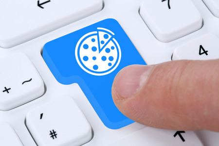 computers online: Ordering pizza online fast food order delivery fastfood internet on computer Stock Photo