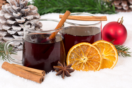 mulled wine spice: Mulled wine on Christmas in winter drinking alcohol drink decoration with snow