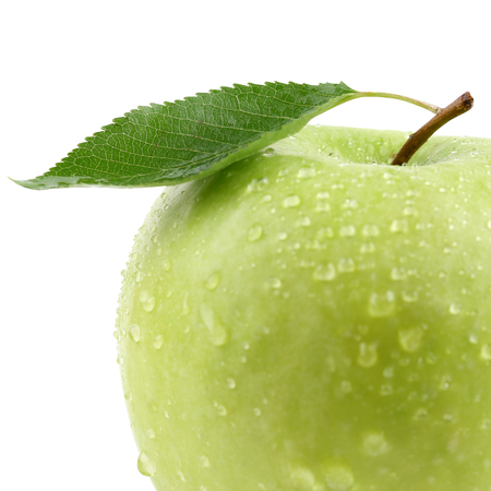 golden apple: Closeup green apple fruit with leaf isolated on a white background