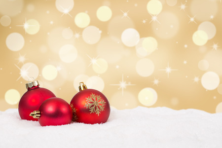 Red Christmas balls golden background decoration with copyspace Archivio Fotografico