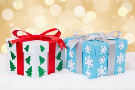 christmas gifts: Christmas gifts decoration with golden background and copyspace for your own text