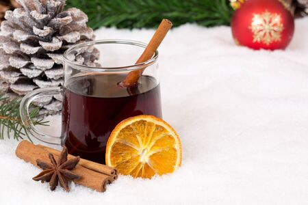 hot drink: Mulled wine on Christmas in winter drinking alcohol drink decoration with snow and copyspace