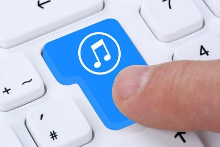 internet keyboard: Computer concept listening music downloading streaming and buying on internet keyboard
